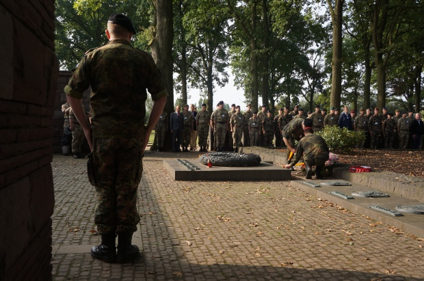 Soldiers from the German, British, French, Australian, Canadian, New Zealand, and Canadian armies salute the German fallen at Langemarck Cemetery, 7 September 2014, during Operation Reflect.