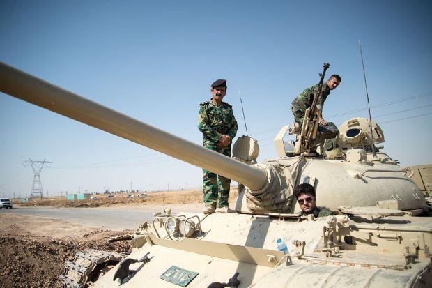 Peshmerga_on_a_T-55-Tank_outside_Kirkuk_in_Iraq.