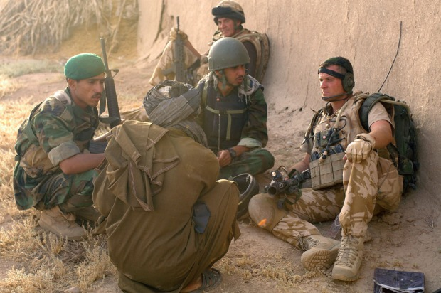 KAJAKI, Afghanistan – British Sgt. Rab McEwan, Kajaki Operational Mentoring Liaison Team, discusses the local situation with a local resident via a translator and Afghan National Army soldier during a patrol north of the Kajaki Dam here June 17, 2008. The ANA soldiers work closely with the British soldiers of the OMLT, which provides mentorship and liaison assistance with ISAF. The ISAF soldiers are responsible for the security of the dam as well as working with the Afghan National Army and Afghan National Police to assist in security for local villages. The dam provides electricity for the majority of Helmand province and Kandahar as well as irrigation control for the region. (ISAF photo by Staff Sgt. Jeffrey Duran, U.S. Army)