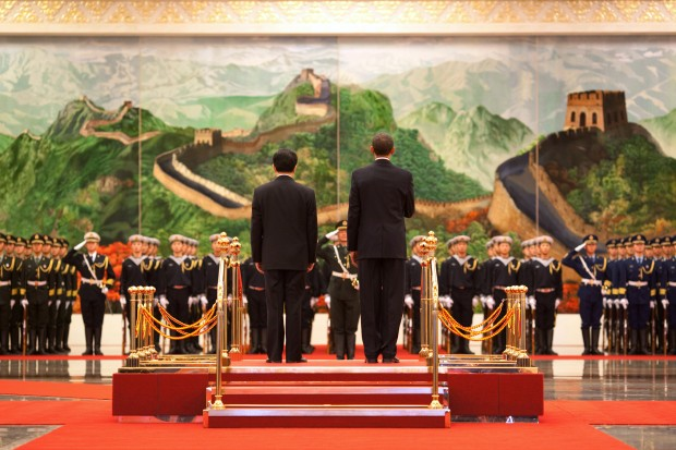 President Barack Obama and Chinese President Hu Jintao participate in an official arrival ceremony at the Great Hall of the People in Beijing, China, Nov. 17, 2009. (Official White House Photo by Pete Souza)  This official White House photograph is being made available only for publication by news organizations and/or for personal use printing by the subject(s) of the photograph. The photograph may not be manipulated in any way and may not be used in commercial or political materials, advertisements, emails, products, promotions that in any way suggests approval or endorsement of the President, the First Family, or the White House.