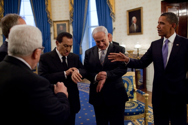 "Sept. 1, 2010 ""Prior to the start of their working dinner during the Middle East negotiations, President Hosni Mubarak of Egypt and Prime Minister Benjamin Netanyahu of Israel check their watches to see if it is officially sunset. During Ramadan, fasting continues throughout the day until after sunset."" (Official White House Photo by Pete Souza)  This official White House photograph is being made available only for publication by news organizations and/or for personal use printing by the subject(s) of the photograph. The photograph may not be manipulated in any way and may not be used in commercial or political materials, advertisements, emails, products, promotions that in any way suggests approval or endorsement of the President, the First Family, or the White House."
