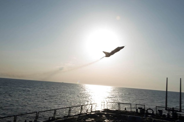A Russian Sukhoi Su-24 attack aircraft flies over USS Donald Cook.