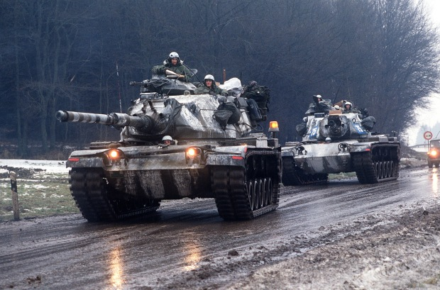 Two M-60A3 main battle tanks move along a road during Central Guardian, a phase of Exercise Reforger '85.