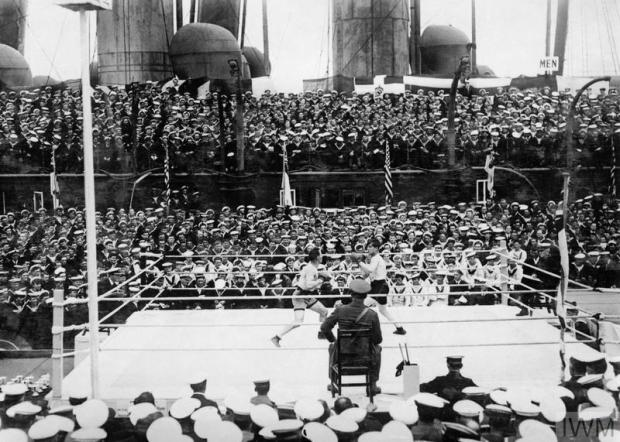 SPORT & LEISURE DURING THE FIRST WORLD WAR (Q 19867) A Middleweight bout at the Grand Fleet Boxing Tournament in 1918 between Chief Carpenter's Mate Gartner (US Navy) and Leading Stoker Roberts (Royal Navy). Copyright: © IWM. Original Source: http://www.iwm.org.uk/collections/item/object/205195327